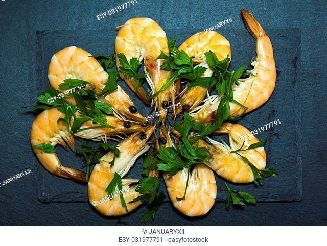 Tasty Shrimp with parsley on a stone slate