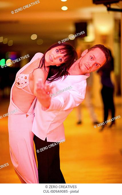 Young ballroom dancers in pose, portrait