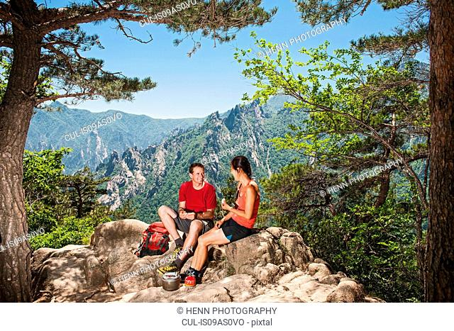Hiking Couple having a break at Seoraksan National park, Gangwon, South Korea