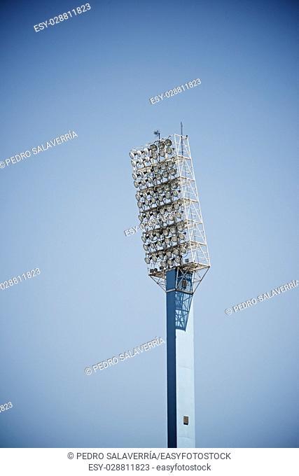 Closeup of a stadium lights with blue sky