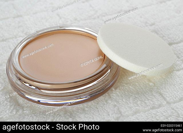 Closeup of container of cosmetics powder