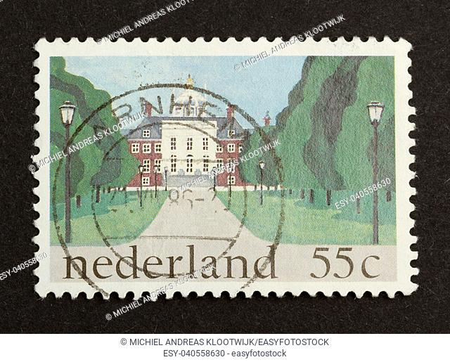 HOLLAND - CIRCA 1980: Stamp printed in the Netherlands shows a large building, circa 1980