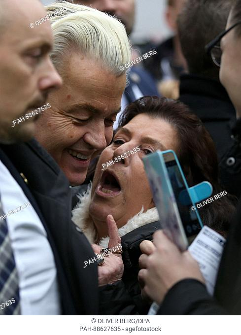 The Dutch rightwing populist and leader of the Partij voor de Vrijheid (Party for Freedom, PVV) Geert Wilders (C) on the campaign trail in Spijkenisse in South...