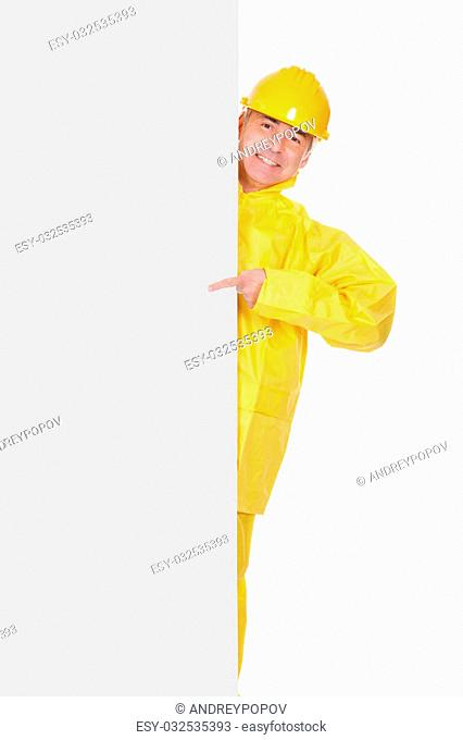 Mature Man Wearing Raincoat And Standing Behind Placard Over White Background