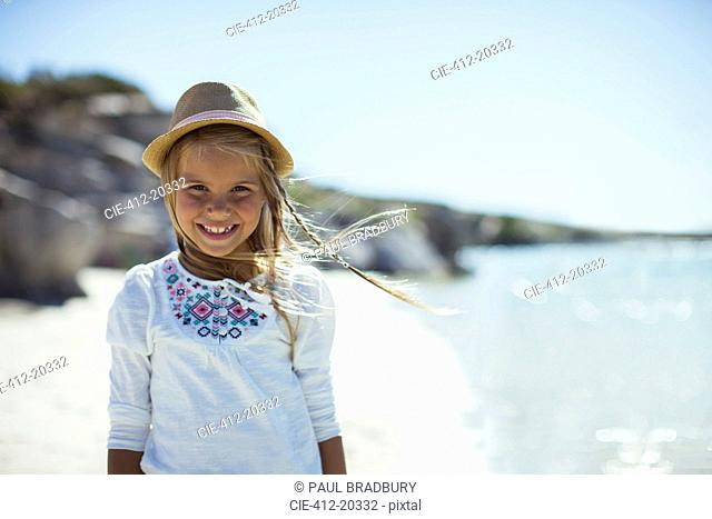 Young girl smiling on beach
