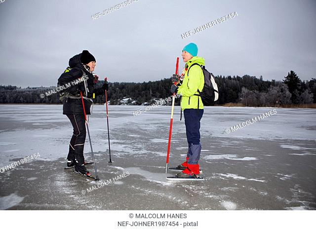 Two women ice-skating
