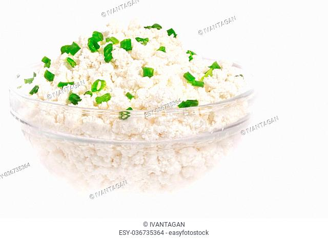 Fresh cottage cheese (curd) in glass bow, isolated on white background