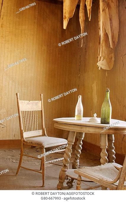 Bottles on dining room table of Bodie residence, California, USA