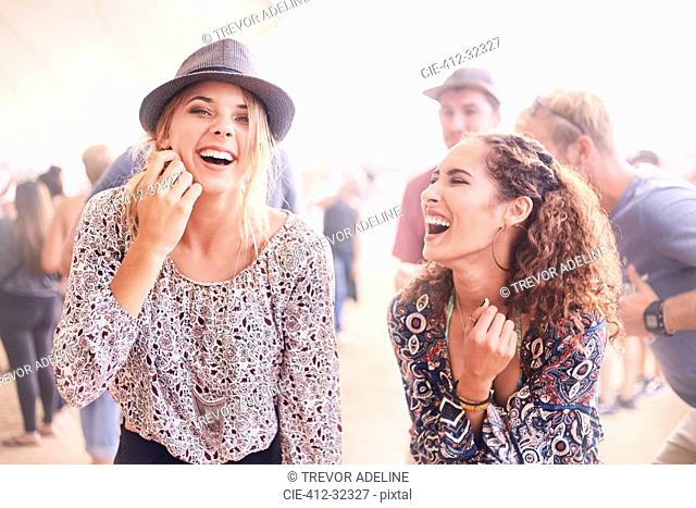 Young women laughing at music festival