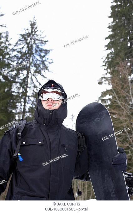 Guy in Technical winter gear, snowboard