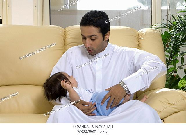 Father holding baby in the living room