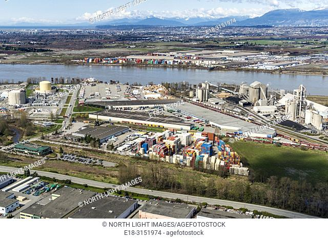 Canada, BC, Delta. Harbourlink container storage facility near the banks of the Fraser River. Cement factory and liquefied natural gas storage facility in the...