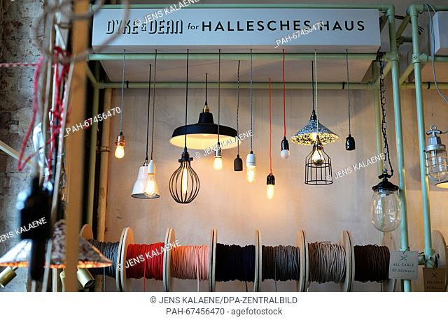 Ceiling lamps and lightbulbs from British brand Marke Dyke & Dean are for sale in the 'Hallesches Haus,' a shop for lifestyle