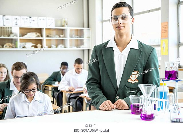 Student in lab, classmates in background