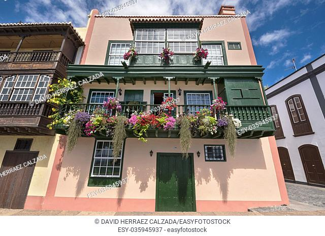 Famous ancient colorful colonies balconies decorated with flowers. Colonial houses facades in Santa Cruz, La Palma island in Spain