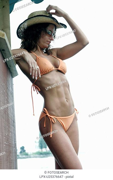 b0c635c7cd9 fit girl posing in a bikini or lingerie with a cowboy hat