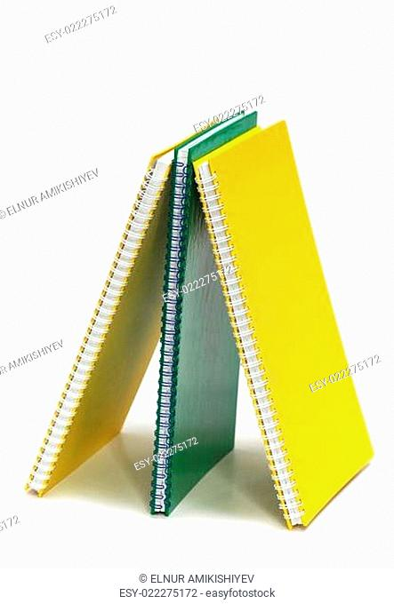 Three binder books isolated on the white