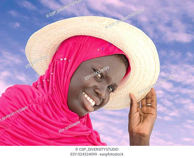 Muslim girl wearing a straw hat