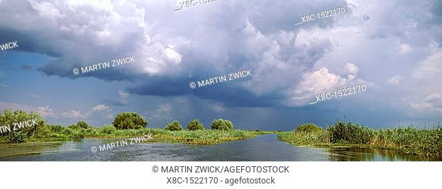 Panorama of lakes and channels in the Danube Delta, romania, thunderstorm clouds form in the air, which is full of moisture from the huge evaporation surface of...