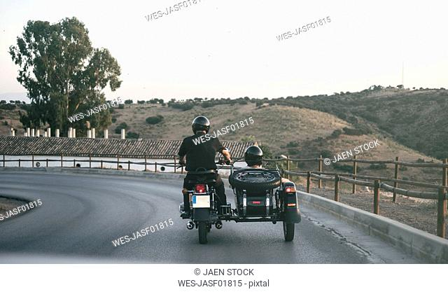 Spain, Jaen, mature couple riding on motorcycle with a sidecar