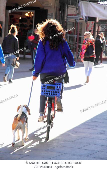 BARCELONA SPAIN-NOVEMBER 18: The old Borne quarter on Nov 18, 2014 in Barcelona. Biker with her dog