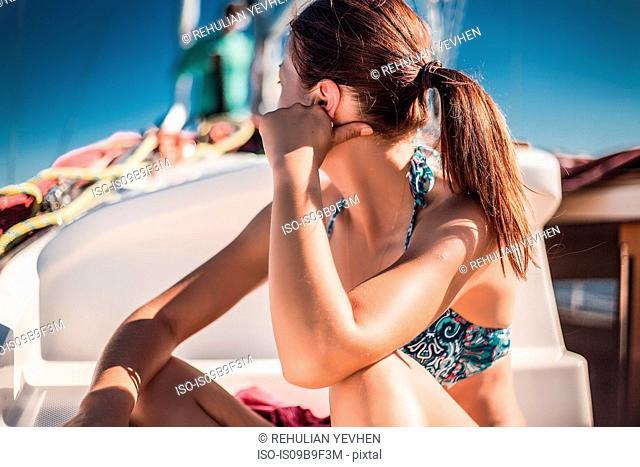 Woman in bikini relaxing on boat