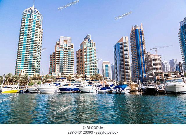 DUBAI, UAE - NOVEMBER 13: Modern buildings in Dubai Marina, Dubai, UAE. In the city of artificial channel length of 3 kilometers along the Persian Gulf