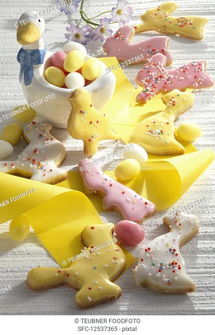 Colourful Easter biscuits with yellow ribbon and Easter eggs