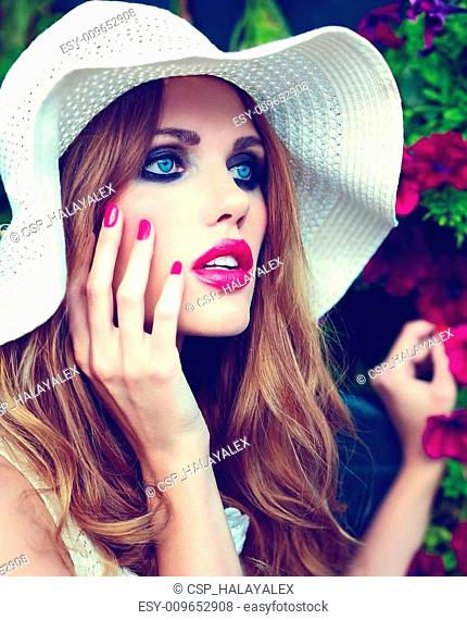High fashion look.glamor closeup portrait of beautiful sexy stylish blond young woman model with bright makeup and pink lips with perfect clean skin in hat blue...