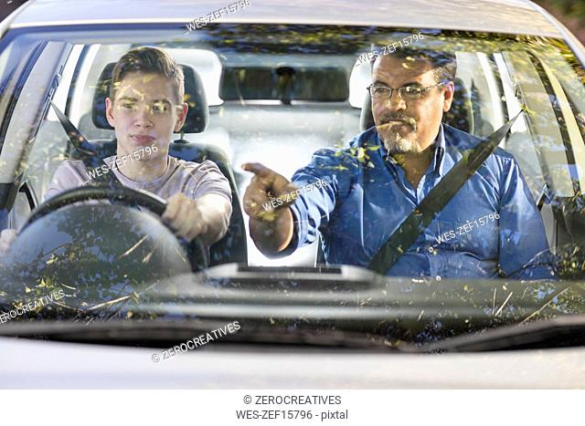 Learner driver with instructor in car