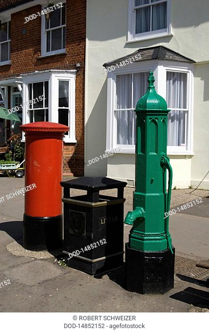 England, Essex, Thaxted, red letterbos, black litter bin, and green water pump