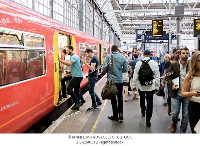 Commuters boarding train, Waterloo station, London, UK