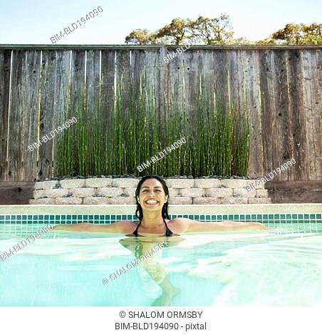 Hispanic woman in swimming pool