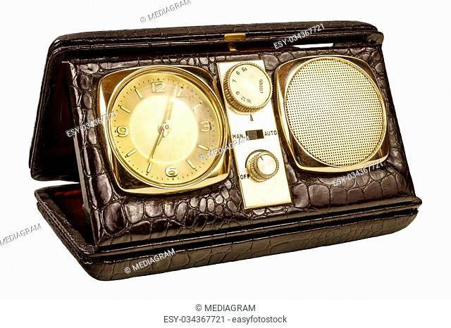 Retro styled image of an old travel clock radio isolated on a white background