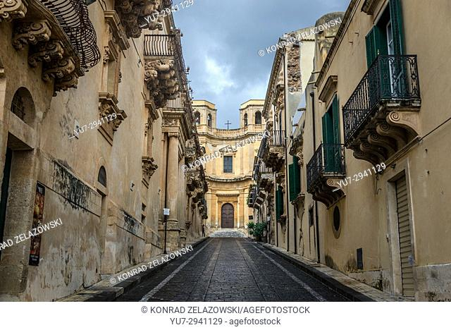 View of narrow street and Church of Montevergine (Chiesa di Montevergine) in Noto town, Province of Syracuse on Sicily Island in Italy