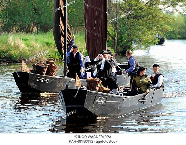 A so-called peat barge armada on the Hamme on their way from Teufelsmoor in Worpswede to Bremen,Germany, 26April 2014. This historic event with reconstructed...