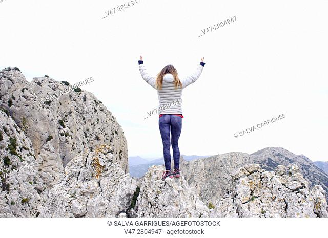 Woman on top of the mountain in Quatretondeta, Alicante, Valencia, Spain