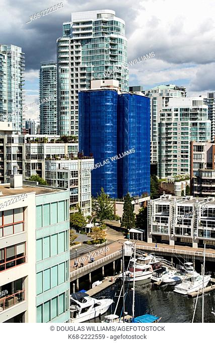 apartment buildings on the north shore of False Creek, Vancouver, BC, Canada. One is covered for repairs