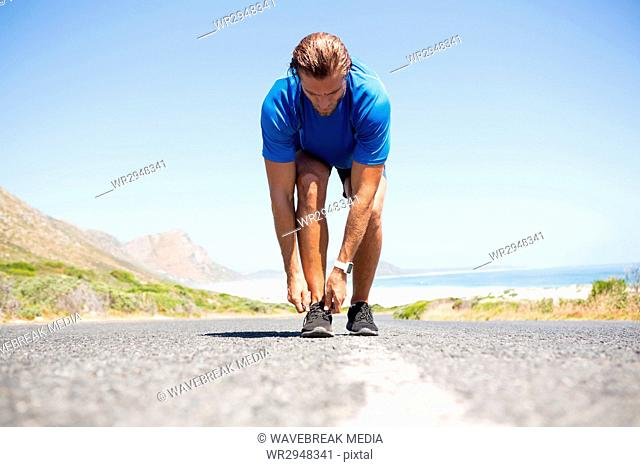 athlete wearing shoes on road