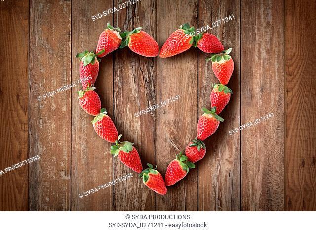 heart shaped frame made of fresh strawberries