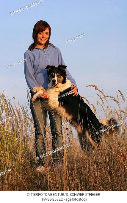 woman and Border Collie