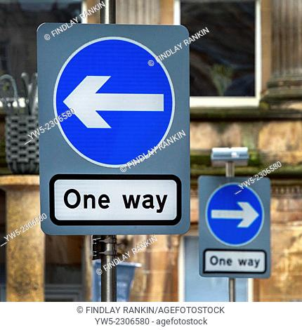 """Two """"""""give way"""""""" road signs indicating oppossite directions to travel, Glaasgow, Scotland, UK"""