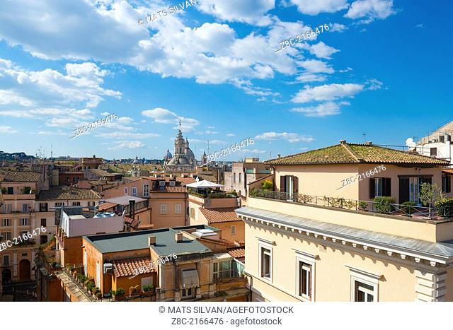 Panoramic view over the roofs with church towers and Basilica di San Pietro tower In Rome, Italy