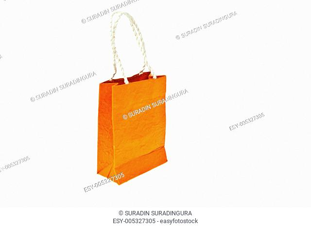 Orange mulberry paper bag isolated on white background