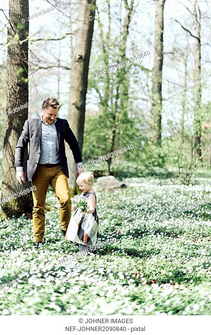 Father with daughter in woods