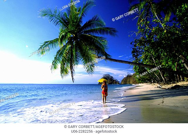 Punta Leona beach on the Pacific coast of Costa Rica showing palm trees and surf