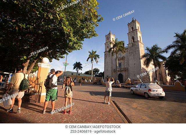 Tourists taking photos of the San Gervasio Cathedral, Valladolid, Yucatan Province, Mexico, Central America