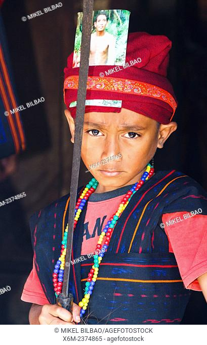 Young boy in ceremony. Bena village. Flores island. Indonesia, Asia