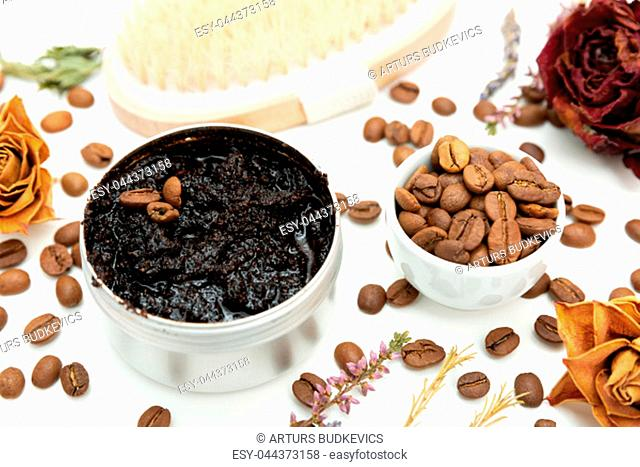 Aromatic botanical cosmetics. Dried herbs flowers mixture, aromatic homemade scrub paste made from coffee grounds and oils