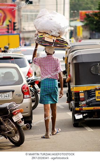A man walks in busy traffic in Trivandrum , Kerala, South India